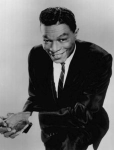 Source: https://commons.wikimedia.org/wiki/File:Nat_King_Cole_2_1964.JPG